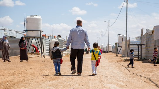 Father with kids in Jordan - refugee settlement - War Child programmes