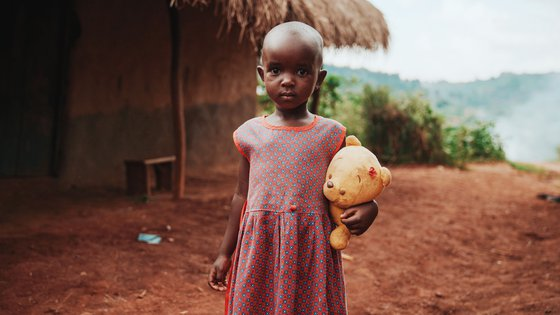 Girl with cuddly bear in Uganda_190419